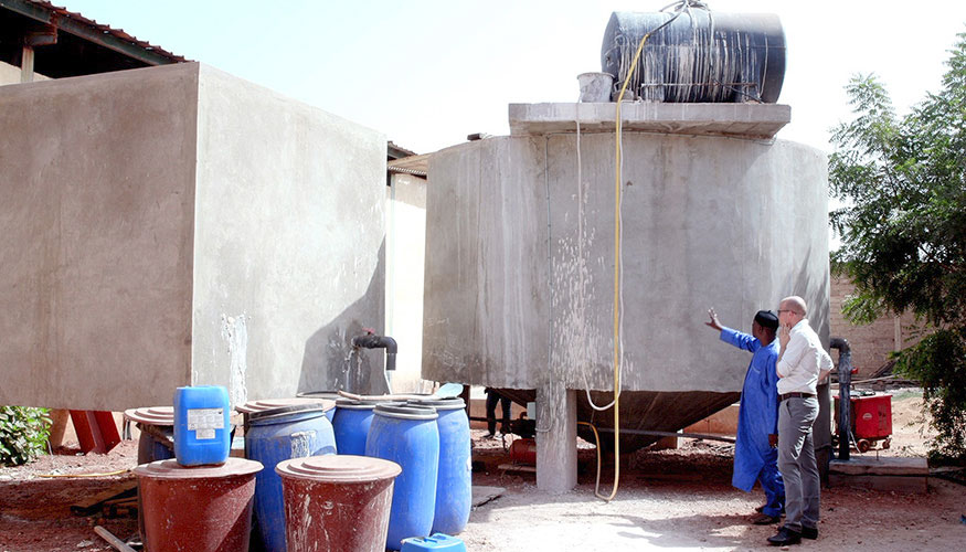 Two men viewing a wastewater treatment plant in Mali